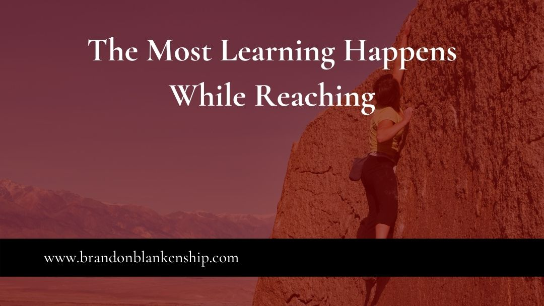 Woman reaching the most learning happens while reaching